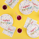happy birthday tableware yellow background